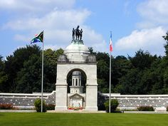 Delville Wood: The memorial, which was designed by Sir Herbert Baker, with sculpture by Alfred Turner, consists of a flint and stone screen either side of an archway, with a shelter at each end of the screen (wikipedia)