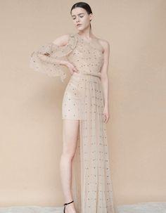 9a6ec65cd203 Einzigartiges Kleid mit asymmetrischem Rock und Punkte. Aus unserer Premium  Kollektion. Sei 2 Schritte