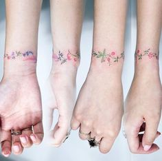 Delicate floral wristband tattoo. #flower #tattoo #floral