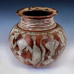 Master Craftsman. A sgraffito vessel, by Dr. Ladi Dosei Kwali (1925-83); Nigeria's best known potter. She was awarded a Doctorate, and was made a MBE (Member of the British Empire) in 1963, for her detail and skill, in creating her pots. Kwali was also a lecturer and had exhibitions of her work, in Europe.