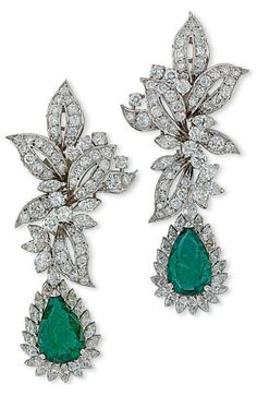 A PAIR OF EMERALD AND DIAMOND EAR PENDANTS, BY CHANTECLER Each mounted with a pear-shaped emerald surrounded by a border of marquise-cut diamonds suspended from the pavé-set diamond foliate surmount, accented by marquise and brilliant-cut diamond detail, 7cm long, rhodium-plated Signed Chantecler Capri