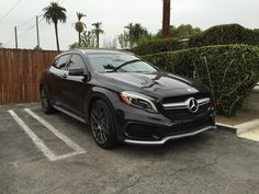 The #Mercedes-Benz GLA45 AMG is some sort of crazy compact crossover #SUV with the new four-door coupe design that's all the rage today. It's like a lifted hatchback that's been tuned by the mad scientists at AMG and given all sorts of aerodynamic goodies to make driving a blast. This black GLA45 AMG is even better thanks to a new set of TSW Wheels. #Discount #Wheels www.wheelhero.com