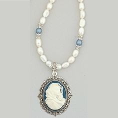 Madonna of the Streets Cameo Pendant  Catholic Jewelry This incredible piece features the beauty of irregular shaped, natural freshwater pearls and lovely round blue beads with antique style caps. The lightweight image of our Blessed Mother brings together the blue and white of the necklace for an elegant addition to your jewelry collection. Necklace measures 19