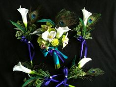 calla lilly & peacock feather bouquet | ... -Round Calla Lilly Peacock bouquet and matching bridesmaids bouquets