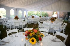 Beautiful Fall Centerpieces Placed on Tables at Tented Reception http://www.busseysflorist.com/bridal-wedding-flowers/
