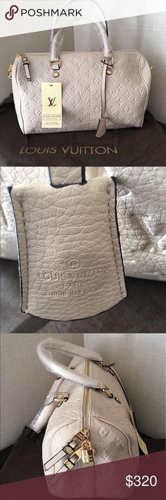 LOUIS VUITTON MM Empreinte Speedy Bandouliere 30 . My favorite Speedy LV bag, perfect cream color Bags Satchels