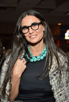 What a spectacle: The actress demure in a pair of glasses, a simple black dress and an aqua necklace