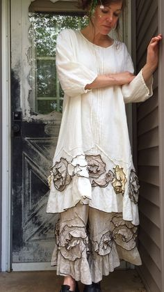 White medium weight linen in a Flouncey Swirl Tunic Dress. A-lined, with ruffled bottom, swirls in light colors, and 3/4 sleeves. M bust 46, length 41. Under neath are bloomers, sold separately. Already made.