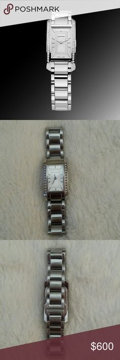 Diamond Watch Authentic Burberry watch in polished stainless steel with genuine diamonds on sides. Swiss quartz movement, push-button hidden deployment clasp. Burberry logo on back and in clasp (see last picture). Water resistant 30M/400 FEET Case size 2cm/0.78 in Excellent condition! ***Please feel free to ask for extra pictures*** Burberry Accessories Watches