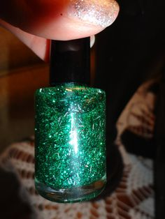 Emerald City nail polish is super glittery and sooo sooo pretty. Mixed with greens and black and a touch of silver shredded tinsel. Paris Sparkles nail polish stands alone. If you want to add a clear top coat for maximum shine, no problem but never necessary. Shown with two coats of polish, no top coat.