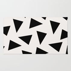black triangle pattern II Rug by Georgiana Paraschiv. Worldwide shipping available at Society6.com. Just one of millions of high quality products available.