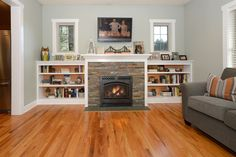 Craftsman Living Room with metal fireplace, Built-in bookshelf, High ceiling, Hardwood floors