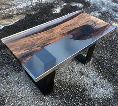 Resin table with wallnut wood. Size 110cm x 200 cm x 10cm You will have a modern table and a piece of nature inside . Option to customize dimensions to make to order. The coffee table is not a problem.