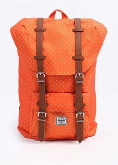 This gorgeous orange-cream and polka-dot bag is fleece lined to keep your laptop nice and snug.