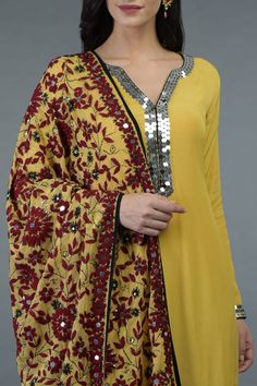This is a mango yellow crepe suit with Phulkari and sequin hand embroidery adorning the kurta front neckline, sleeve ends and all over dupatta. The kurta has a round shaped neckline and inches long front neck V slit. Designer Dress For Men, Indian Designer Outfits, Designer Dresses, Dress Neck Designs, Designs For Dresses, Kurti Designs Party Wear, Kurta Designs, Pakistani Dress Design, Pakistani Dresses