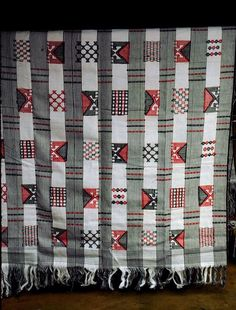 Africa | Akwete cloth from the Igbo people of southern Nigeria. | Photo by Lisa Aronson. || This Akwete cloth combines an 'ikaki' design with several other patterns in a linear grid arrangement, the overall effect of which resembles a strip weave. In this example of Akwete cloth, the 'ikaki' design is barely detectable.