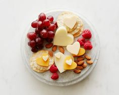 Hot Date Cheese Plate : Use a mini heart cutter to shape cheddar, Havarti or other semi-firm cheeses into cute little tokens of affection that will appeal to both adults and the toddler set.