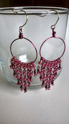 Magenta beaded hoop earnings