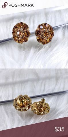 "Vintage Amber Orange Rhinestone Post Earrings These are amazing. The most brilliant orange amber coloring in a circular cluster of rhinestones. Pierced stud post earrings. .75"" diam. Unsigned mid century. Gold tone mixed metal alloy. Only flaw is they have two different types of back closures but that can be changed vintage studs rarely have the closures still. Bohemian art nouveau. 🌟 Save the most with bundles. I offer 25% OFF on 2+ items and accept reasonable offers on items & bundles. NO…"