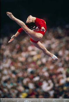 Yang Bo performing the move named after her on Balance Beam at the 1991 World Championships in Indianapolis. Yang Bo may have been known as the greatest ever on the apparatus if it wasn't for her repeated failure to stick her dismounts.