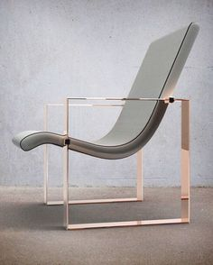 love the combination of rose coloured gold frame and grey leather for a chair. tres chic.