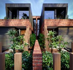 Contemporary Dual occupancy, duplex design in Sydney. Custom designed luxury residences in Matraville. Brick, stone, glass, metal cladding, internal gardens, natural light and ventilation, indoor outdoor living, creative use of space, efficient & creative planning.