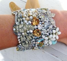 Oh I want to do this...An excellent way to re-use all those broken bits of costume jewelry I have accumulated. by deana