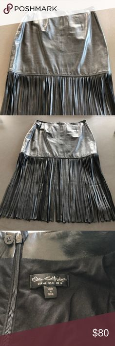 """NWOT Miss Selfridge leather fringe skirt Loved it. Bought it. Never wore it. 😭😭😭 New without tags. 100% leather with 100% cotton lining. Size 8 but runs a little big in my opinion. Skirt is 15"""" from top to bottom, fringe adds 15.5"""" to length. Top to bottom 31"""". 15.5"""" across waist and 19"""" at hips. Miss Selfridge Skirts"""