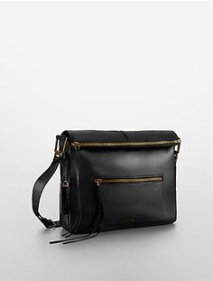 the aster shoulder bag features a foldover top zip close and adjustable shoulder strap.