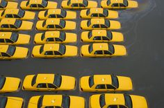 A parking lot full of yellow cabs is flooded as a result of superstorm Sandy on Tuesday, Oct. 30, 2012 in Hoboken, NJ.   // Charles Sykes