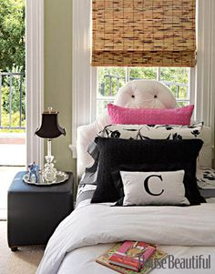 A Sophisticated, Feminine Bedroom  In this little girl's room by Ken Fulk Design, white faux patent leather headboards were custom-made. The black-and-white bedding completes the look of the bed.