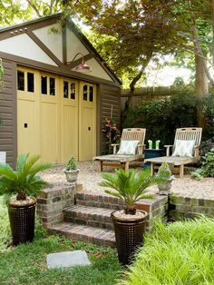 In place of car storage, this garage offers a focal point for an outdoor living retreat. The doors -- painted a cheery yellow -- slide to the side to open and supply a covered spot for outdoor dining and relaxing. A gravel area offers a softer edge to the patio, and an oversize barn-style light casts a soft glow at the space's entry.