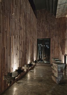 Dramatic timber walls inside Mexico City's M. N. ROY bar, designed by Ludwig Godefroy and Emmanuel Picault.