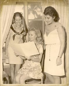Did you think #Macklemore was the first to recognize the value of a thrift shop? Not so!  @Junior League of the Palm Beaches opened their Thrift Boutique in September of 1956. Here, Mrs. Charles M. Huttig, Mrs. George Matthews, and Mrs. Jackson Thatcher meet at The Flagler Museum for the Junior League Thrift Boutique committee.  Mrs. Thatcher served as Thrift Boutique Chair, Mrs. Matthews as the Thrift Boutique Tea Chair, and Mrs. Huttig as the Thrift Boutique Tea Hostess.