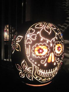 Handcarved day of the dead sugar skull table lamp.