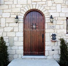 What a lovely Rustic Castle Door. This Round Top Exterior Door is perfect for a wine cellar door. Just imagine having all of your specialty wines hidden & locked away behind this ancient knotty alder wooden door. This and many others at www.nicksbuilding.com  #solidwoodexteriordoors #rusticexteriordoors #roundtopdoors