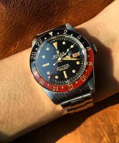 """Going to the flower market and getting ready for CNY with the Rolex GMT Master ref. 6542 Bakelite in full gilt gloss under natural sunlight"""