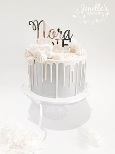 Silver and white drip cake. By Jenelle's Custom Cakes. Topper by Glistening Occasions.