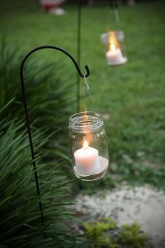 put in colored sand and flameless candles Blissful Whimsy Events: Hanging Mason Jar Candles DIY / North Carolina Wedding Planner Hanging Mason Jars, Mason Jar Candles, Mason Jar Lighting, Mason Jar Diy, Diy Candles, Flameless Candles, Garden Candles, Yankee Candles, Citronella Candles