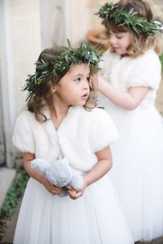 Faux Fur Inspiration for Brides and Bridesmaids Faux fur accessories make such a stylish addition to any flower girl dress. Paired with greenery crowns it's an easy and stylish ensemble for a winter wedding. Winter Flower Girl, Winter Wedding Flowers, Flower Girls, Flower Girl Dresses, Flower Crowns, Christmas Wedding Dresses, Winter Wedding Fur, Flower Girl Crown, Winter Weddings