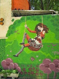 swinging girl - street art in Rio de Janeiro, Brazil