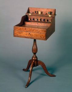 Shaker Deaconesses sewing desk with twelve painted spools Probably Union Village, Ohio, circa 1840 Curly cherry, cherry, and poplar with a w. Sewing Desk, Sewing Cabinet, Sewing Table, Sewing Box, Sewing Rooms, Vintage Sewing Notions, Antique Sewing Machines, Vintage Sewing Patterns, Shaker Furniture