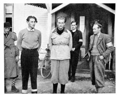 Two Norwegian Gestapo agents arrested by members of the resistance May 1945. Arne Braa Saaatvedt, in white jacket, was executed at Akershus castle, Oslo, in October the same year after being found guilty of torture and murder.