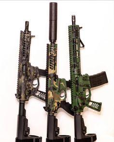 Falkor Defense AR's Cerakoted in multiple camo patterns.