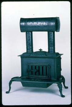 Cast Iron Parlor Stove with Two Pipes and Smoke Chamber, c. 1840, thought to have been made near Poultney, Vermont,
