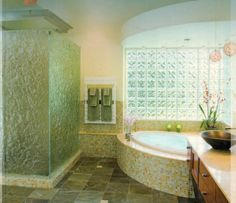 Love all this glass in this bathroom