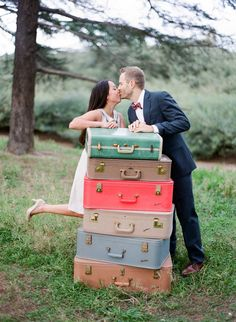 A secret kiss behind a pile of vintage suitcases. Bowtie and Bloom #wanderlust #travelbugs