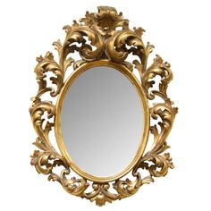 Carved Giltwood Italian Oval Mirror | From a unique collection of antique and modern wall mirrors at https://www.1stdibs.com/furniture/mirrors/wall-mirrors/