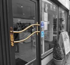 The award winning hair and beauty salon The Strand have their Facebook and Twitter tags located just by the entrance to make following so simple and effective.