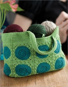 Crochet Granny Square Bag---Great idea with the inset handles, I've never thought about trying that before.